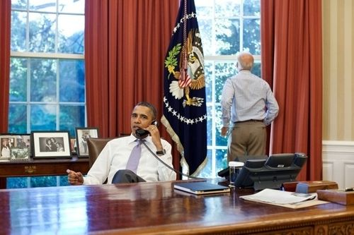 '[Vice President Joe] Biden looks out the window as [President] Obama speaks on the phone with House Speaker John Boehner in the Oval Office to discuss the debt limit and deficit reduction.' — Pete Souza / The White House, July 31, 2011