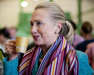 Secretary of State Hillary Clinton enjoys a cup of coffee as she tours the Timor Coffee Cooperative in Dili, East Timor, Sept. 6, 2012 (fair use photo credit: AP) via http://www.cbsnews.com