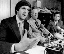 Middlesex County 1st Assistant DA John Kerry explains to the press on June 16, 1978, that an investigation into possible criminal charges stemming from US Senator Edward Brooke's admitted 'misstatements' in his first divorce trial was ordered that day by Middlesex DA John Droney, right. Middlesex Assistant DA Richard Kelly looks on.