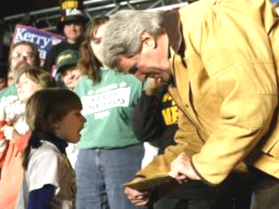 Reuters' caption: 'Democratic presidential nominee John Kerry reads a note given to him by five-year-old Michaela Fishback (L) at a campaign rally in Waterloo, Iowa October 19, 2004. The note said 'John Kerry Rools.''