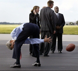 Kerry, outside his campaign plane before departing from Tampa to Orlando for a campaign stop on Friday, Oct. 1, 2004.  Yahoo News caption: 'Democratic presidential candidate John Kerry plays football whilst on the campaign trail. More than 62 million US viewers tuned in to the first of three presidential debates in this year's election campaign, making it the most watched since 1992, according to Nielsen Media Research (AFP/Luke Frazza)'