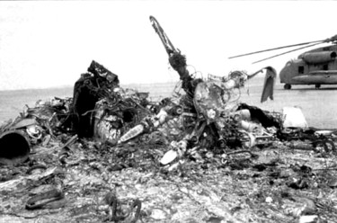 The burned out wreckage of one of the RH-53 Sea Stallion helicopters was discovered and photographed the next morning by the Iranian military. An intact RH-53 sits in the background. It was decided during the evacuation from Desert One not to destroy the remaining helicopters for fear of damaging the C-130s, the force's ride out of Iran. 'The accident was a calamity heaped on despair. It was devastating,' wrote retired Col. James Kyle in his book, 'The Guts to Try.' He was the on-scene commander at Desert One.