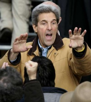 Reuters' caption: 'U.S. Democratic presidential nominee John Kerry reacts to the crowd at a rally in Des Moines, Iowa, October 30, 2004.'