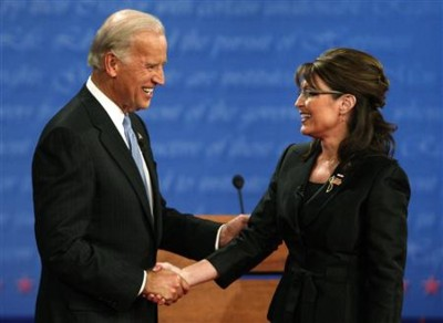 Gov. Sarah Palin greets Sen. Joe Biden before their vice presidential debate (Reuters photo)