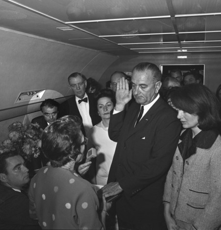 Jack Valenti, left in highlighted circle, as LBJ is sworn in