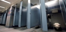 Airport men's room stalls, credit: Newsweek