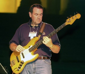 'Old Hippie' Mike Huckabee playing the bass guitar at a 2008 campaign function