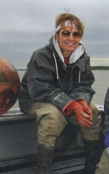 Sarah Palin relaxes after hauling in salmon nets aboard her husband's commercial fishing boat