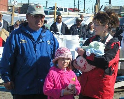 Gov. Sarah Palin, with daughter Piper and infant son Trig, meet Mayor Edward Itta in Barrow, Alaska, on the last day of the annual whaling festival