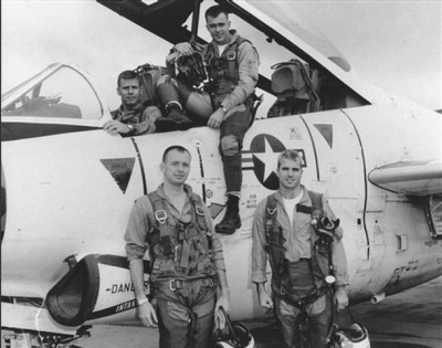 John McCain and comrades in around a U.S. Navy A-4 attack aircraft